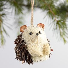 Our handcrafted hedgehog ornaments sparkle with natural fiber and glitter. This adorable set includes four critters: two copper and two painted white with clear glitter.