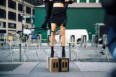Step up: The model's sporty crop top was paired with a black mini skirt that showed off he...