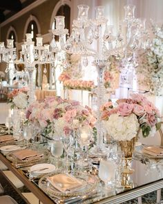 This crystal-covered, floral-filled tablescape is major #weddinggoals! | Photography By: Mango Studios | WedLuxe Magazine | #WedLuxe #Wedding #luxury #weddinginspiration #luxurywedding #weddingideas #reception #weddingdecorations #gardenwedding #whitewedding