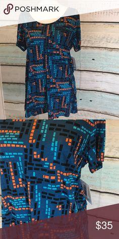 LuLaRoe Classic T size Large nwt LuLaRoe Classic T size Large nwt.  ⭐️ Price firm unless bundled. LuLaRoe Tops Tees - Short Sleeve