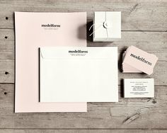 My own identity with hand stamped stationery in white and pale pink/nude. Embossed businesscards.