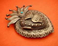 ANTIQUED Mexican SACRED HEART - http://www.etsy.com/listing/72650463/antiqued-mexican-sacred-heart-locket