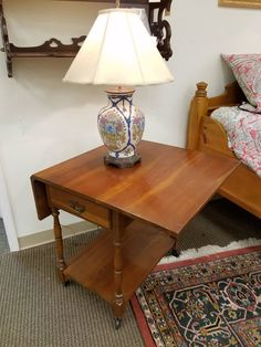 This drop leaf server opens on both sides and priced at only $59.