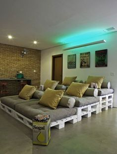 Designer Simone Tasca stacked twelve reclaimed wood shipping pallets and created one comfortable looking spot to invite a group of friends to lay back and watch a movie