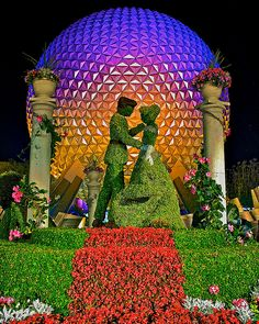 Cinderella & Prince Charming Topiary in front of Spaceship Earth at Epcot, Walt Disney World, FL