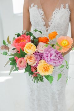 Spring blossomed lilac, coral, and yellow wedding bouquet: Photography : Kelly Kollar Photography Read More on SMP: http://www.stylemepretty.com/2016/09/01/colorful-spring-loft-wedding-in-nyc/