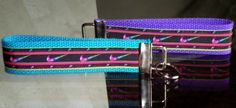 This listing is for a 6 inch long key fob made of high quality grosgrain ribbon and heavy-duty cotton webbing.  It has a nickel fob tip and split ring.  The ribbon is black with multicolored Nike logo