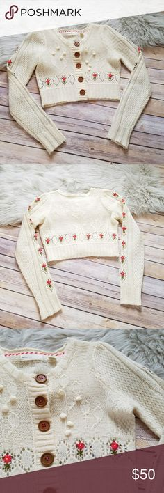 """Anthro Sleeping on Snow cropped flower cardigan Size X-Small. Anthropologie Sleeping on Snow button front cropped sweater. Beautiful flower embroidery stitched in. There is a very small miscolored thread on the back of one arm. Shown in pic 7 and 8. It's barely noticeable. Otherwise excellent used condition! Bust - 17.5"""" Length - 14"""" Anthropologie Sweaters Cardigans"""