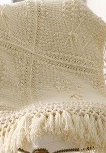This Aran Crochet Nosegay blanket has a beautiful crochet flower pattern that gives off a relaxed, vintage crochet vibe.  | AllFreeCrochetAfghanPatterns.com