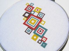 Mod squares cross stitch design in cotton embroidery floss on white cotton fabric. Securely mounted in a 6 vintage metal embroidery hoop. Cross Stitch Art, Simple Cross Stitch, Cross Stitch Borders, Modern Cross Stitch, Cross Stitch Designs, Cross Stitching, Cross Stitch Embroidery, Cross Stitch Patterns, Hand Embroidery Designs