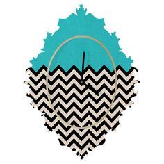 Add eye-catching appeal to your entryway or kitchen with this baroque-inspired wall clock, showcasing a striking chevron motif and aqua accent.