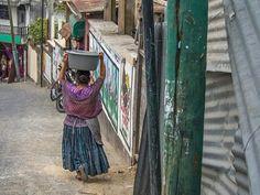 Mayan woman traversing the steep roads if San Pedro lake Atitlan.  #Guatemala #Mayan #maya #lakeatitlan #atitlan #travel #culture #travelphotography #streetphotography #melbournephotographer by cyril_foto