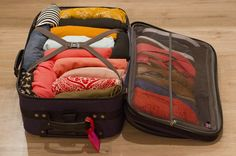 great tips for packing clothes for a trip - look at all the shoes in the zipper compartment!