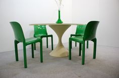 tulip table and cassina chairs