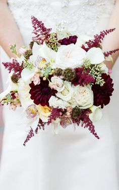 This bouquet is filled with all different types of flowers (roses, peonies, and orchids) and, therefore, lots of texture. The deep marsala dahlias are stunning, and the rich color brings to mind a... #beautifulflowersroses