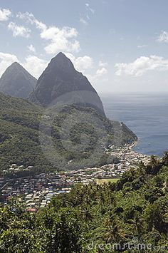 """The Piton mountains and the village of Soufriere in St. Lucia. #Caribbean (for a larger picture visit the site and click on """"comp image"""")"""