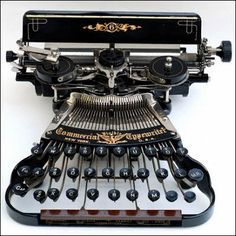 This beautiful 1898 Commercial Visible Typewriter types from a type wheel, that is easy to remove, allowing for a quick change of font. To make an impression, a spring loaded hammer behind the carriage swings forward, striking the paper and ribbon against the type wheel.