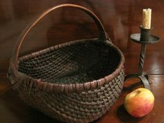 Antique 1800s Early New England Black Ash Woven Splint Farm Egg Gathering Basket.  Look closely at this Early American Primitive Antique Hand Made New England Basket.   There is very little loss to this early New England Basket.  The Handle is made of bentwood and also has an old worn patina on the handle from years of carrying.  Look at the Woven God's Eye Pattern that graces both side of this Gorgeous Antique Basket.    | eBay  sold  295.00