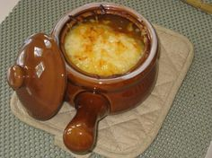 French Onion Soup >> probably one of the better recipes I've found! The crock reminds me of the ones my sister got me for Christmas. :)