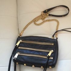 This gorgeous black leather Rebecca Minkoff purse with gold zip detailing, fringe and studded bottom is my favorite purse.