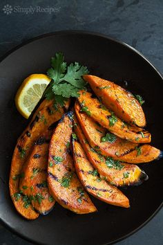 Grilled Sweet Potatoes ~ Slices of sweet potatoes grilled over a hot fire and slathered with a cilantro-lime dressing. ~ SimplyRecipes.com