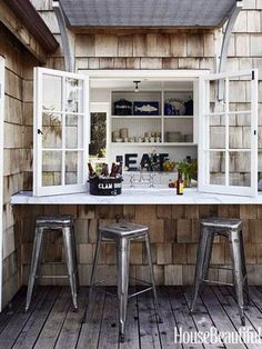 a kitchen that opens into a porch bar.