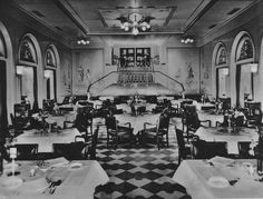 The Second Class Speisesaal (Dining Room) of the steamship Europa, consort flagship of the Norddeutscher Lloyd (North German Lloyd). 1930. The extraordinary bifurcated staircase gave the space a decorative edge over its First Class counterpart. Image courtesy the private collection of John Cunard-Shutter.