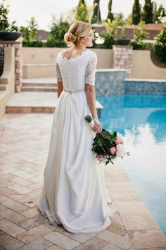 The back buttons! The Lace sleeves! The pined up skirt! Aaaaah!  Beautiful Chiffon Lace Wedding Dress with Modest Sleeves