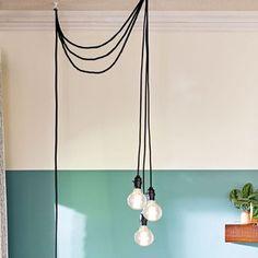 Hanging pendants with Edison bulbs. Edison Lighting, Pendant Lighting, Edison Bulbs, Living Room Lighting, Living Room Decor, Wooden Screen, Decorative Bird Houses, Lamp Cord, Apartments