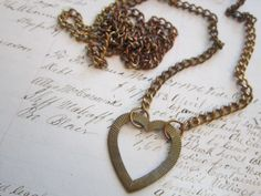 vintage HEART pendant on 36 inch chain. $6.95, via Etsy.