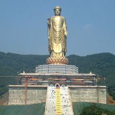 The Spring Temple Buddha located in Henan, China is the tallest statue in the world at 502 feet.  The hill it stands on is being excavated to make a taller base; it is planned to stand 682 feet after this renovation.  For comparison, the Statue of Liberty is 305 feet tall, including its base. | Loved and pinned by www.downdogboutique.com