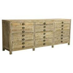 "Reclaimed pine wood apothecary chest.   Product: Apothecary chestConstruction Material: Reclaimed pineColor: WhitewashedFeatures:  Three 2"" deep map drawersAntique brass hardware Dimensions: 35.5"" H x 90.5"" W x 19.5"" D"