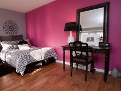 Accent wall in violet fuchsia brings a sense of luxury to the bedroom