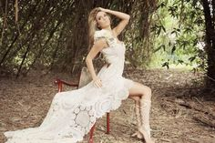 https://www.cityblis.com/5715/item/10875  Cream Crochet Gown - $368 by Damsel in this Dress  Stunning one of a kind vintage inspired crochet dress, hand stitched and embellished from once loved crochet pieces, trinkets and flowers. The base of the gown is slightly sheer, featuring a long train, perfect for your dream beach wedding, or special event.  This dress is a made to order garment ...