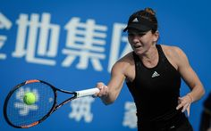 Simona Halep of Romania hits a return to Zheng Saisai of China during their singles semi final match at the Shenzhen Open WTA Tennis tournament in Shenzhen, south China's Guangdong province on January 9, 2015