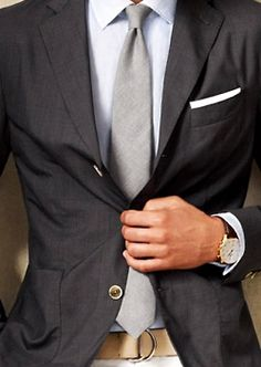 Sleek grey tie and English tan belt.