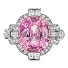 Pink sapphire and diamond ring, centering a natural cushion-cut pink sapphire weighing carats, accented by a fancy-cut diamond surround including two bullet-cut, six baguette-cut and 30 round-cut diamonds, mounted in platinum. Designed by Raymond C. Pink Jewelry, Sapphire Jewelry, Art Deco Jewelry, Gemstone Jewelry, Jewelry Design, Jewelry Rings, Jewlery, Vintage Jewelry, Platinum Diamond Rings