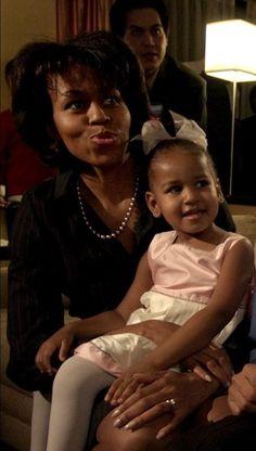Michelle Obama Holding 3 year old Sasha (2004)