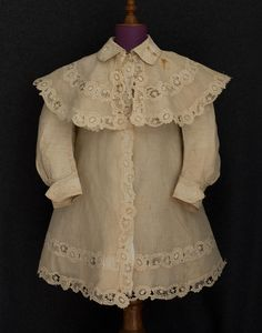 Child's linen coat set, c.1905. Closes in front with 3 fancy mother-of-pearl buttons. Fine finishing. Front view