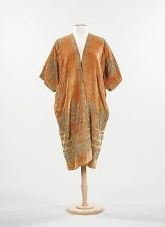 Evening coat, c. 1925, by Mariano Fortuny. From the collections of the Brooklyn Museum Costume Collection at The Metropolitan Museum of Art.
