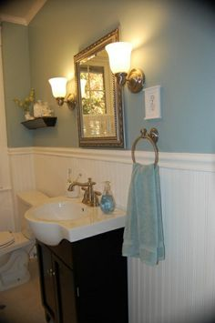 I like this wall color; the sink & vanity is interesting