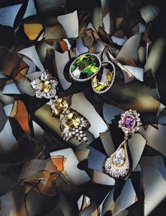 Clockwise, from top James de Givenchy for Taffin 18k yellow gold, peridot, tourmaline, and diamond earrings; Cindy Chao 18k yellow and white gold, purple sapphire, and yellow and white diamond earrings; Van Cleef  Arpels 18k white gold, yellow sapphire, and diamond earrings.