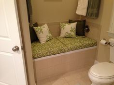 """My formerly unused bathtub is now a useful bench with the help of some plywood, 3"""" foam, and Sunbrella fabric."""