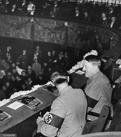 zigarettenliebfuhrer:  Joseph Goebbels and Adolf Hitler in cinema.