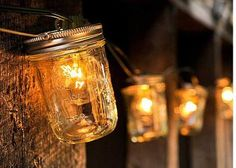 Who else thinks we could make these?  Hello summer patio!  Mason Jar Lights | Bourbon & Boots