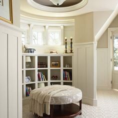 The trim is Benjamin Moore Glacier White - AC-40 and the wall is Benjamin Moore Manchester Tan HC-81.""