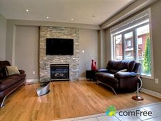 Family Room - TV Embeded In Stone Faced Wall