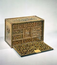 """The Metropolitan Museum of Art - Cabinet of Drawers in Nanban (Southern Barbarian) Style. Period: Momoyama period (1573–1615) Date: ca. 1590 Culture: Japan Medium: Lacquered wood decorated with gold flat maki-e (""""sprinkled design"""") and inlaid mother-of-pearl."""
