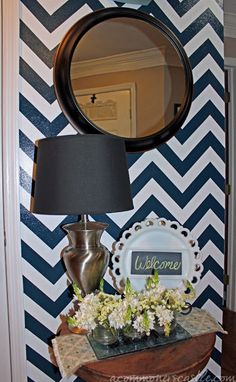 beautiful navy chevron striped wall -- full tutorial #chevron #stripe #painting #wall