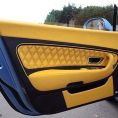 bentley continental GT blue with yellow and black interior